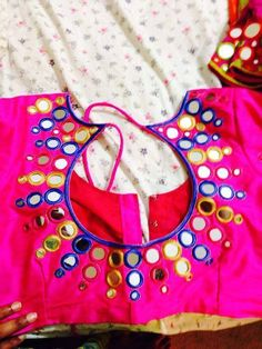 Top Beautiful Mirror work Blouse Designs Latest designs :- Mirror work blouse designs have become fashion now. When a mirror work blouse is combined with a plain saree it will give stunning a… Fancy Blouse Designs, Blouse Neck Designs, Blouse Neck Models, Hand Work Embroidery, Embroidery Blouses, Beaded Embroidery, Mirror Work Blouse Design, Saree Blouse Patterns, Sari Blouse