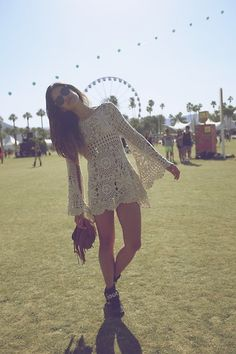 And here she is again -- classic Coachella in a crochet dress (UNIF), booties, and a fringed purse (Jill from littleblackboots.com)
