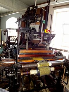 "This is a 42"" example complete with dobby. A dobby a mechanical heald lifting device which allowed weaving of much more intricate patterns on any looms to which it was fitted. this loom was originally used on Harris to produce tweed. It is still regularly used here at the Museum."