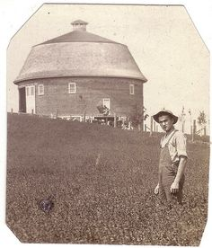 Round barn & farmer on Flickr.The barns & houses are still there.en.wikipedia.org/wiki/University_of_Illinois_round_barns