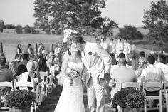 Kiss at the end of the aisle - Rustic Grace Estate Wedding - www.emilydavisphoto.com