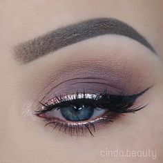 Modern Eye Makeup Idea~ Silver and black cat eye. Notice the subtle glow of silverish gold on the bottom opens up the eye. Perfect brow