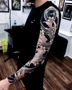 Japanese tattoo sleeve by @joe_carpenter. #japaneseink #japanesetattoo #irezumi #tebori #bngink #blackandgrey #blackandgreytattoo #cooltattoo #largetattoo #armtattoo #tattoosleeve #flowertattoo #cherryblossomtattoo #newschool #newschooltattoo #blackwork #blackink #blacktattoo #wavetattoo #naturetattoo