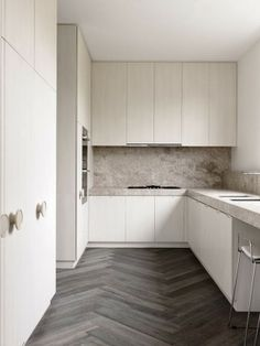 Beautiful colors and materials except for the ugly door handles on the cabinets. House in Toorak by Chamberlain Javens Architects.