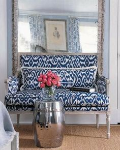 Blue and white love seat + pink roses + silver end table.
