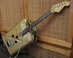 A military gas can resonator guitar built by Tex Wynn.