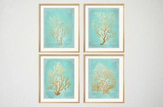 Set of four golden coral silhouettes against an aqua mint colored background. Perfect addition to the contemporary home, dorm room or modern