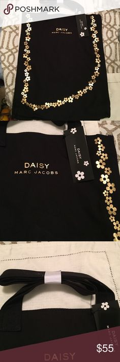 Marc Jacobs Daisy Bag Brand new! Gorgeous metallic gold daisies grace the perimeter of this bag with the iconic Marc Jacobs logo front and center. Also comes with a nice drop strap for easy on the go wear! Marc Jacobs Bags