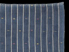 Detail: FR561 - Subtle and beautiful chief's robe cloth from the Abron or Koulango peoples of the Bondoukou region in north eastern Côte D'Ivoire. Unique minimal design achieved by regular blocks of narrow white weft stripes that combine with the white pinstripes in the warp to produce blocks of blue and white check that alternate regularly with striped areas of equal size. http://www.adireafricantextiles.com/francophone4.htm
