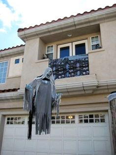 2015 Halloween ghost decoration with foam heads and cheesecloth - LoveItSoMuch.com