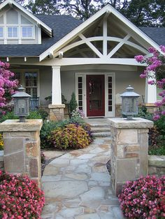 I love the path to the front door... A unique project--turning a ranch house in an historic neighborhood of Craftsman bungalows and various 1910s and 20s period revivals into--a welcoming Craftsman with a Southern-sized front porch and an extensively gardened yard.  The project added a 2nd story, an upstairs porch, a large dining room, as well as a rather radical aesthetic overhaul.