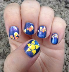 Nail art inspired by Rapunzel's floating lanterns in Tangled.