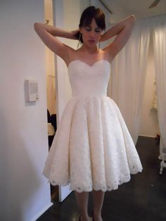 I love tea length dresses for an afternoon garden wedding and a tea party reception with dancing in the starlight after dark.