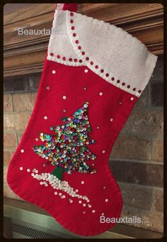 2 - 16 felt Christmas stockings featuring a sequined Christmas tree sitting on a bed of fresh snow.  White / Red - Tori  White / Blue - Rex