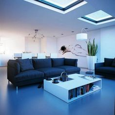 Cool Blue Living Room Stylishly Lit Up By Deft Placing Of Skylights. Large  Sanseveria In Large Container For Organic Balance.