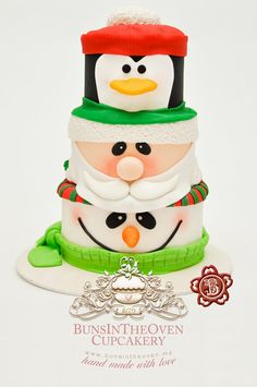Inspired by a stack of Christmas cookie tins. this Santa, Penguin, Snowman Cake will have you squealing! An adorable Christmas cake by BunsInTheOven Cupcakery. Cute Christmas Ideas, Noel Christmas, Christmas Goodies, Christmas Treats, Christmas Baking, Xmas, Christmas Cakes, Funny Christmas, Christmas Wedding