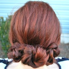 Wearing my hair like this right now.  My hair is in so many layers that it's a little thin at the ends of the braids so it's more just pinned, than in any sort of bun.  I also didn't have the thin clear elastics which would actually be WAY better for this style...have big ol' 'ouchless' ones stuffed in there.