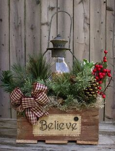 This gorgeous piece is featured in the Country Sampler Magazine! Reclaimed barn wood box 12x12x16, 16 black lantern with battery-operated timer candle, country greens, berries, pine cones, rusty b