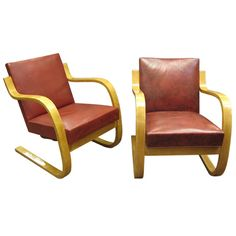 Pair of early, original cantilever chairs, stamped Alvar Aalto 1