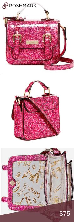 """Kate Spade Glitter Pink/Red Scout Satchel Bag Like mother like daughter, your little mini me is never too young for her first Kate Spade 👛 bag With its single top handle, adjustable shoulder strap - fold over front flap, magnetic closure and dual buckle it's sure to mimic one of mommies Kate Spade Purses. Exterior features gusseted front pocket under flap and coated glitter design. Interior features slip wall pocket.  Measures Approx. 5"""" H x 6.25"""" W x 1.75"""" D Approx. 2"""" handle drop, 13-16""""…"""