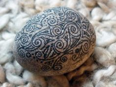 Decorative pebble paperweight with hand drawn Celtic style ornate ink decoration. $9.00, via Etsy.