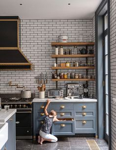 Subway tile kitchen | Gold detail. I would probably get rid of the gold detail and do silver.