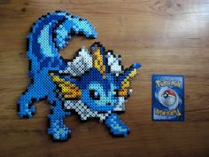 Vaporeon Pokemon Perler Bead Sprite by PokePerlers on Etsy Hama Beads Pokemon, Pokemon Craft, Pearler Bead Patterns, Perler Patterns, Pokemon Cross Stitch, Pixel Art, 8bit Art, Hama Beads Design, Peler Beads