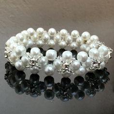Elegant Pearl Bracelet With Sew-on Crystals by DIYJewelryMaking on Etsy https://www.etsy.com/listing/289042551/elegant-pearl-bracelet-with-sew-on