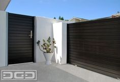 Modern wood entry gates and contemporary rolling gates by Dynamic Garage Door. Custom Design & Manufacturing Call us now! (855) 343-3667 by Pinky and the Brain