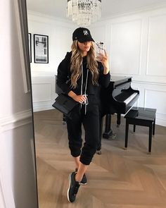 fashion blogger mia mia mine wearing a black sweatsuit with nike cortez sneakers and a ny yankees baseball cap. click through for more athleisure outfits for women, lounge sets, sweatpants outfits, quarantine style, and target fashion finds. #casualootd #athleisure #style #nike Cap Outfits For Women, Sneaker Outfits Women, Sporty Outfits, Trendy Outfits, Fashion Outfits, Clothes For Women, Gym Outfits, Girly Outfits, Black Cap Outfit