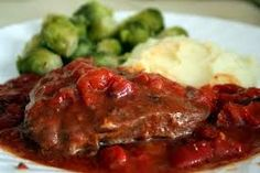 Swiss Steak: crock pot recipe. Buy 'London Broil'/ top round steak, 1 for every 2 people you are serving. Brown on all sides along w/diced bacon. Add water or beef bouillon to pan to deglaze. Put steak(s), pan liquid, 1 can Italian stewed tomatoes per 2 servings, ringed onions & bell pepper strips (mushrooms optional) into crockpot. Add Tsp Worcestershire for every 2 servings. Some add a can cream of mushroom soup if making 4+ servings. A little brown sugar doesn't hurt. Cook on low for 8…