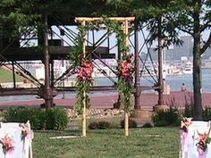 Bamboo arch decorated with garlands  www.myfloralimpressions.com Floral Impressions 410.329.1406 Hunt Valley, MD