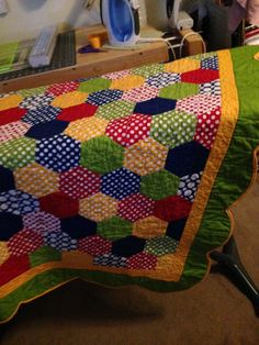 Baby quilt, primary colors, hexi, scalloped border.