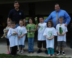 The winners of the Lackawanna County fishing derby in the 4 to 8 years old age group were, from left, Molly Hubal, Dominick Rinaldi, Mariah Adryen, Alexandra Kostik, Alex Hanson, Annabell Farell and Michael Zuzzio. Back row, from left, William Davis, the county's deputy director of parks and recreation; and Commissioner Patrick M. O'Malley.