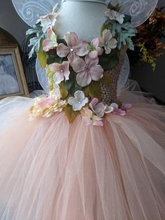 Exquisite Earth tone peach pink ivory beige fairy tutu dress. each strip of tulle is carefully trimmed to have distressed edges that create this wonderful ethereal effect. Crochet top with satin foliage and satin flowers with rhinestones on front panel and cover front neckline and
