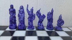 Chess is a classic game loved for generations. This beautiful set is our Good Vs. Evil set. Featuring all of your favorite fantasy Characters; Wizards, dragons, unicorns, dwarfs and more.  The tallest piece is 6 and the shortest piece is 4 the bases are 1 3/4 in diameter and work