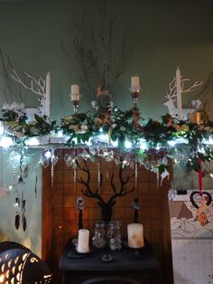 The Dining Room Mantelpiece 2014. This year the theme centers around the stag and natural materials. The 2D stags were cut out and the others were bought. White    fresh flowers, candles and glass enhanced the effect.