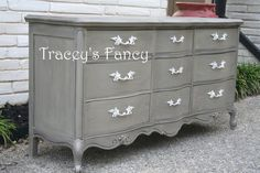 """Brownish-Gray"" and lightly distressed and washed in an espresso stain for a well loved and worn look! A layer of wax was hand buffed for a natural sheen. It is completed with ivory chippy handles. This dresser has a very soft velvety look to it!"