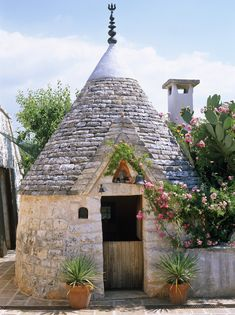 Trullo is a traditional Apulian dry stone hut with conical roof. Style specific to the Itria Valley, in the Murge area of Italian region of Apulia.