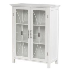 Elegant Home Fashions Hayes Two Door Floor Cabinet in White at Lowe's. The Hayes double door floor cabinet in a white finish offers storage with style for the bathroom. Featuring an elegant crown molded top and adjustable Bathroom Wall Cabinets, Bathroom Furniture, Bathroom Storage, Bathrooms Decor, Accent Furniture, Bathroom Ideas, Outdoor Furniture, Elegant Home Decor, Elegant Homes