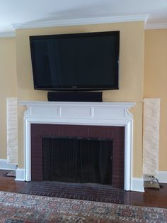 How do you mount a TV above a fireplace on a brick wall without showing unsightly wires? Conceal the video and power cables in wire conduit, then paint the conduit to match your wall. A soundbar below the TV provides improved sound and minimizes the amount of wire molding.