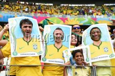 BRAZIL, Fortaleza : Brazil fans pose prior to the Group A football match between Brazil and Mexico in the Castelao Stadium in Fortaleza during the 2014 FIFA World Cup on June 17, 2014. AFP PHOTO / VANDERLEI ALMEIDA