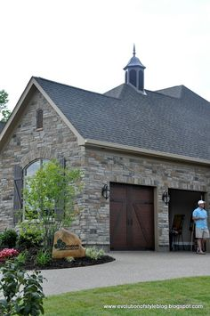Love the style elements- carriage garage doors, shutters, stone. Evolution of Style: Homearama 2013 - House Tour French Exterior, Stone Exterior, Carriage Doors, Carriage House, Elegant Chandeliers, Stone Houses, Stone Cottages, House On The Rock, House Siding