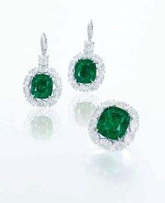 A rare pair of 8.02 and 7.63 carats cushion-shaped Colombian emerald and diamond ear pendants & A rare 17.15 carats cushion-shaped Colombian emerald and diamond ring.