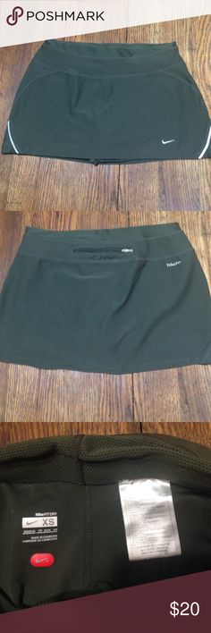 Nike olive green fit dry skort size xs Nike olive green fit dry skort size xs, polyester spandex blend, zipper pocket in back , good condition Nike Shorts