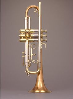 "The Retro ""Renaissance"" Custom Shop trumpet by Andy Taylor, Norwich, 1995, with a vintage look and decoration features, such as arched braces with abalone pearls. British five pence form th fingerbuttons"