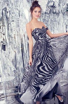 Go wild. Dress in zebra print.
