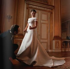 Crown Princess Victoria of Sweden being fitted in her wedding gown
