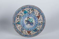 A Minai bowl Iran, Kashan, late 12th - early 13th Century Fritware with polychrome paint (haft rang, seven colours) on an opaque white glaze