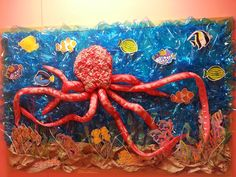 Under the sea bulletin board! Installation foam, pool noodles, and suction cups!